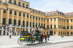Coach with people in Schonbrunn Palace, Vienna. Beautiful view of the facade Schonbrunn Palace, Vienna Stock Photos