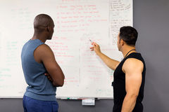 Coach planning gym session Royalty Free Stock Image