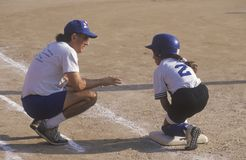 Coach with player on base, Stock Images