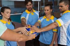 Coach with players holding volleyball Stock Photography