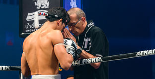 Coach Praying before the match for Antoine Pinto of France in Thai Fight Extreme 2013. Stock Image