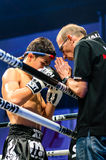Coach Praying before the match for Leo Pinto of France in Thai Fight Extreme 2013. Stock Images