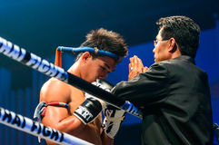 Coach Praying before the match for Peemai Jitmuangon of Thailand in Thai Fight Extreme 2013. Stock Images