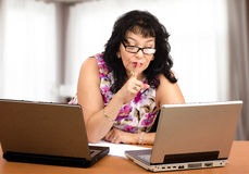 Coach puts finger to lips during webinar Stock Photos