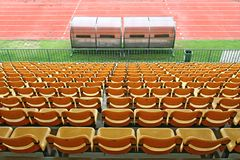 Coach and reserve benches in football stadium Stock Image