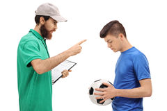 Coach scolding a teenage soccer player Stock Photo