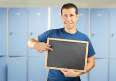 Coach showing a blackboard Royalty Free Stock Photos