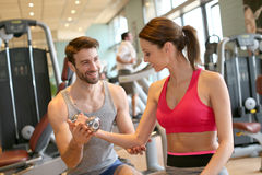 Coach showing a fitness girl excercises Stock Photo