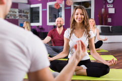 Coach showing to learners yoga posture Stock Photo