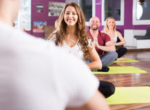 Coach showing to learners yoga posture. Coach showing to adult persons new yoga posture at class Stock Images