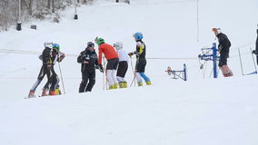 Coach speech with skiers stock footage
