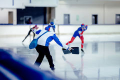 Coach speed skaters Royalty Free Stock Photos