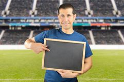 Coach showing the strategy in match with the chalkboard Royalty Free Stock Photography