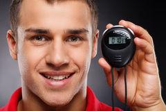 Coach with stopwatch. Portrait of young Royalty Free Stock Photo