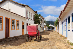 Coach on street, old colonial houses in Paraty, Brazil Stock Photos