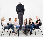 Coach and support group during psychological Stock Photography