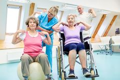 Coach takes care of seniors during training royalty free stock photos