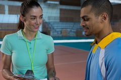Coach talking with male volleyball player Royalty Free Stock Image