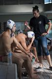 Coach talking to waterpolo players at a match in Angouleme, France, in October 2014.  Royalty Free Stock Photo
