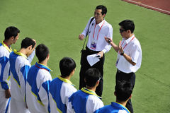 Coach and team,Encourage team. The 9th national traditional games of ethnic minority of the people's republic of china,the image showing Coaches are encouraging Royalty Free Stock Photos