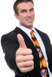 Coach with Thumbs Up. A handsome man coach with a basketball sport tie Royalty Free Stock Photography
