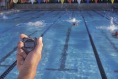 Coach timing swimmers,. Ojai, CA royalty free stock images