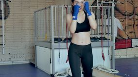Coach training female boxer on sports studio in gym. 4k stock footage