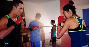 Coach training a woman with boxing. In boxing ring stock video
