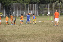 The coach is the training of young football players in CHINA,SHENZHEN Stock Photography