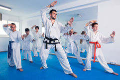 Coach is training young teenagers. In karate class Royalty Free Stock Image