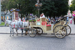 Coach with two harnessed horses in Lvov Stock Photo