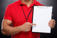 Coach with Whiteboard. Trainer showing on whiteboard Stock Images