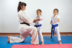 Coach woman showing martial art for children. Coach women showing martial art for children. Fighting position, active lifestyle, practicing fighting techniques stock images