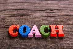 Coach word made of wooden letters Royalty Free Stock Photography