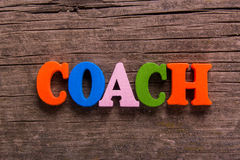 Coach word made of wooden letters Stock Photos