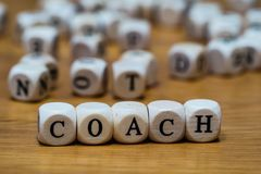 Coach written with wooden cubes royalty free stock photography