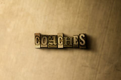 COACHES - close-up of grungy vintage typeset word on metal backdrop Royalty Free Stock Photography