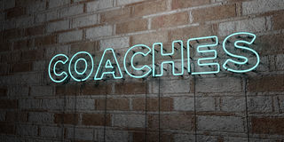 COACHES - Glowing Neon Sign on stonework wall - 3D rendered royalty free stock illustration Stock Image