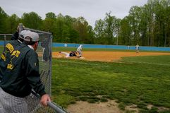 Coaches watch a baseball game in Maryland royalty free stock photos