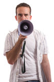Coaching. A young coach is talking into a megaphone, isolated against a white background Royalty Free Stock Image