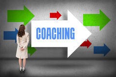 Coaching against arrows pointing stock photography
