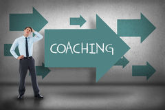Coaching against blue arrows pointing Royalty Free Stock Photo