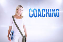 Coaching against grey background Royalty Free Stock Photos
