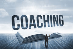 Coaching against open book against sky Royalty Free Stock Photography
