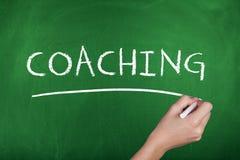 Coaching Background Concept. Coaching word hand writing chalkboard Stock Photo