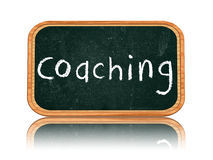 Coaching on blackboard banner Royalty Free Stock Photo