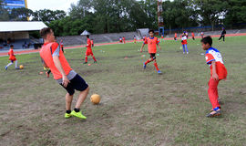 Coaching clinic. Players of American football team provides coaching clinic for junior high school students at a stadium in the city of Solo, Central Java Royalty Free Stock Images