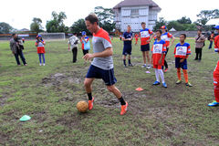 Coaching clinic. Players of American football team provides coaching clinic for junior high school students at a stadium in the city of Solo, Central Java Stock Images