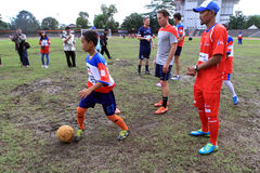 Coaching clinic. Players of American football team provides coaching clinic for junior high school students at a stadium in the city of Solo, Central Java Royalty Free Stock Photography