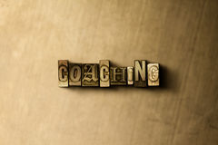 COACHING - close-up of grungy vintage typeset word on metal backdrop. Royalty free stock - 3D rendered stock image.  Can be used for online banner ads and Royalty Free Stock Photo